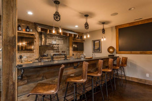 Your custom home needs an incredible lower level bar.