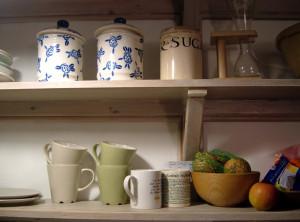 Open shelves help custom home kitchens feel bigger.