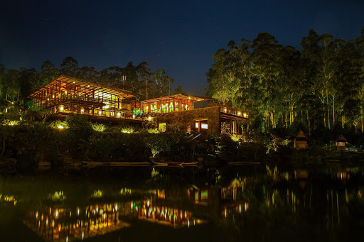 lakehouse lit up at night over the water